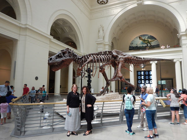 Jolynn Willink, Field Museum ADA/504 Coordinator, and Jennifer Skulski pose here with world-famous Sue, the T-Rex, before she moved to her new exhibit home.