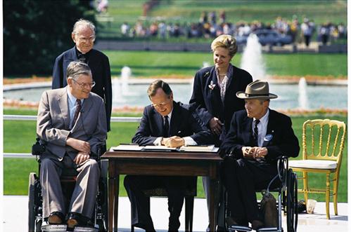 President Bush signs ADA.